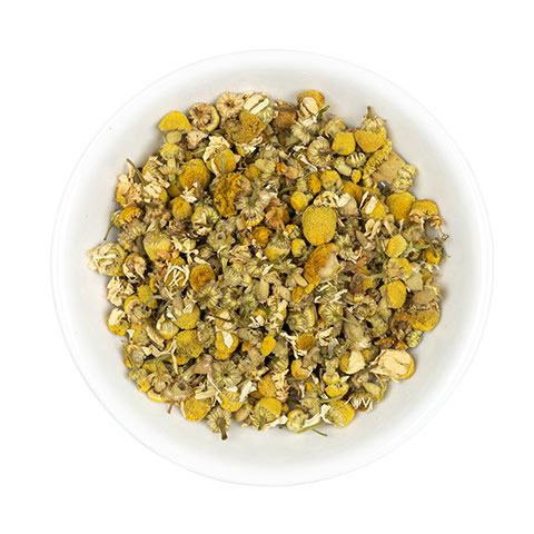 Chamomile flowers in dish